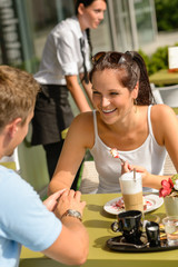 Couple enjoy coffee dessert restaurant terrace
