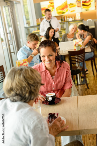 Senior woman with her daughter at cafe