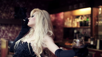 Gorgeous femme fatale with cigarette in bar, steadicam shot