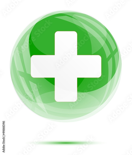 White medical sign in the green glass sphere