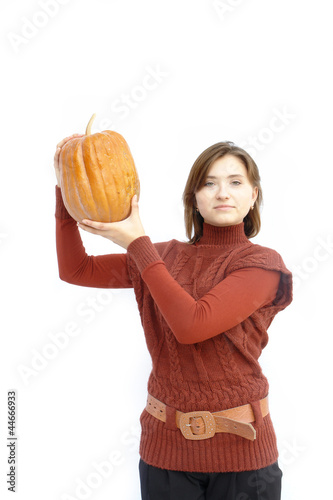 Pumpkin for Halloween. A girl holding a pumpkin on his shoulder