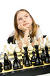 Cute girl playing chess on white