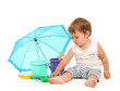 Cute baby with bucket and spade near umbrella isolated on white