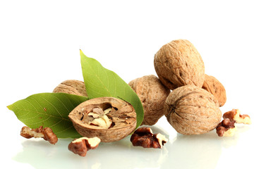walnuts with green leaves, isolated on white