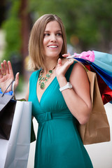 Happy Woman Shopping in City