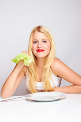 healthy food - young blond smiling woman