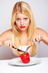 healthy food - young blond sad woman