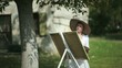 Woman enjoying painting outdoors; Full HD Photo JPEG