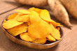 Crispy Peruvian sweet potato chips on wooden plate
