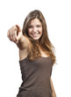 Happy woman with hand pointing at you - isolated over a white ba