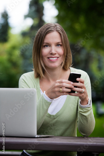 Attractive Woman in Park with Smart Phone
