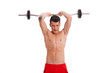 young shirtless man lifting a barbell above head