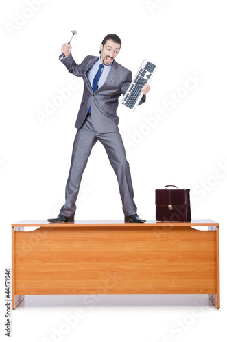 Businessman breaking his computer