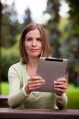 Woman with Digital Tablet Outdoors