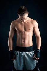 Sportsman boxer intense portrait in studio