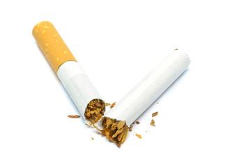 A cigarette broken in half on a white background