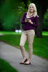 Woman in Park with Cell Phone