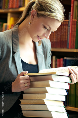 Woman doing research in library