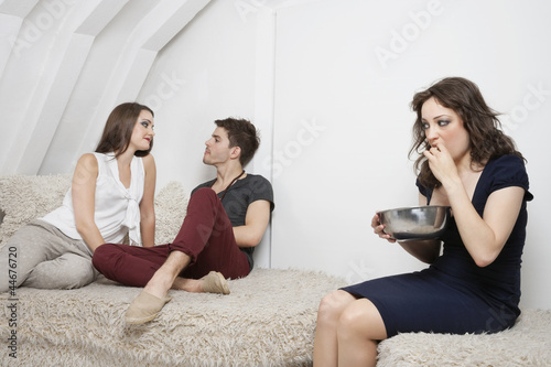 Young woman watching couple have quality time together
