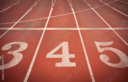 Numbers 3, 4 and 5 on running track. Perspective view.