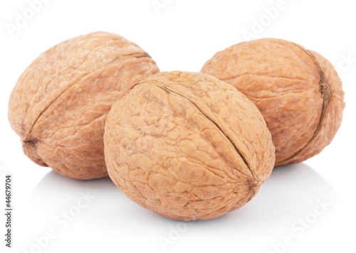 Three walnuts on white