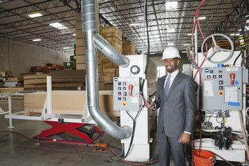 Portrait of an African American male engineer in timber factory
