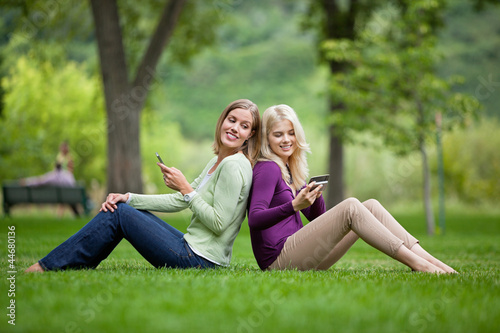 Women With Cellphones In Park