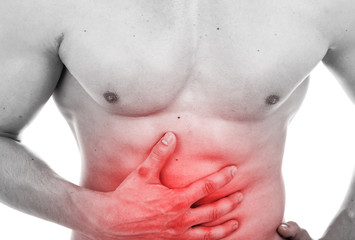 Muscular man with stomach pain, isolated on white