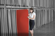 Portrait of mid adult businesswoman holding thin red veneer sheet