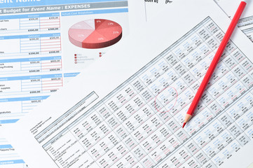 red pencil over financial reports
