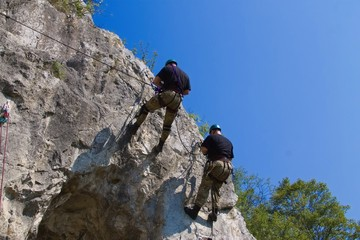 Two men carried abseiling
