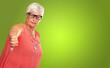 Leinwanddruck Bild - Senior Woman With Thumbs Down