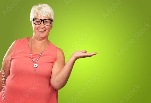 Leinwanddruck Bild Portrait Of A Senior Woman Presenting