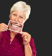 Senior Woman With Magnifying Glass Showing Teeth