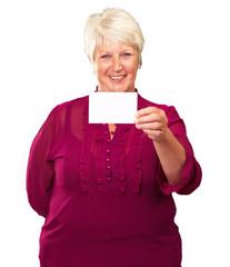 Portrait Of A Senior Woman Holding A Blank Card