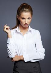 beautiful businesswoman portrait, gray background
