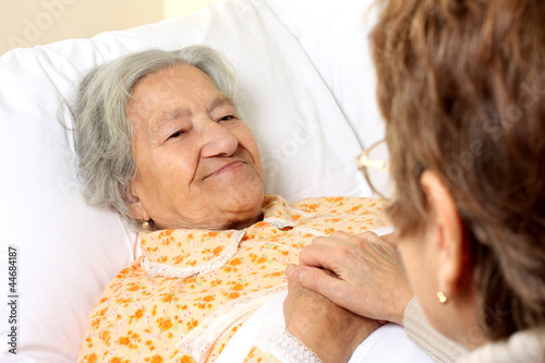 Elderly woman lying in bed