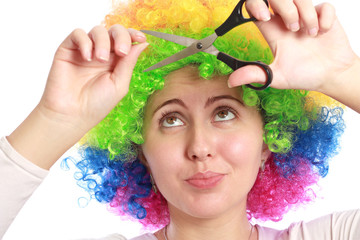 Woman with colorful hair and scissors