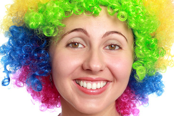 Young woman smiling with clown hair
