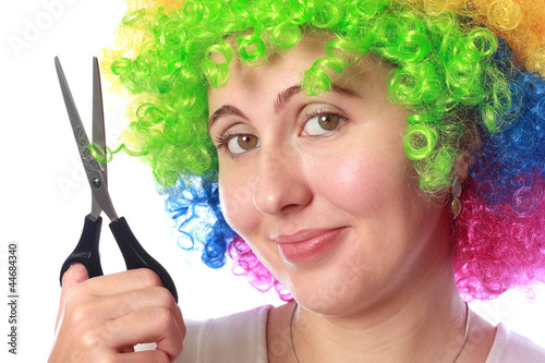 Woman with clown hair and scissors