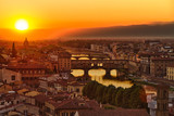 Fototapety Florence, Arno River and Ponte Vecchio at sunset, Italy