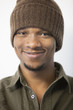 Close-up portrait of an African American man wearing knit hat