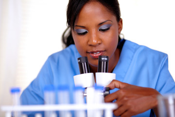 Young woman using a microscope