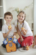 Portrait of little boy and girl with cup cakes