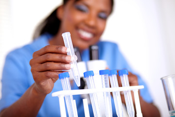 Scientific young woman working with test tube