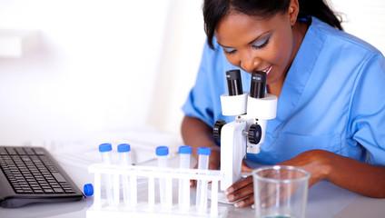 Scientific woman in blue uniform working
