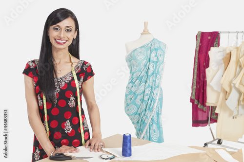 Portrait of beautiful Indian female tailor smiling