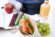 Well balanced school lunch sandwich fruit bag books