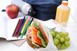 Well balanced school lunch sandwich fruit bag books