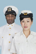 Portrait of two US Navy officers over light blue background
